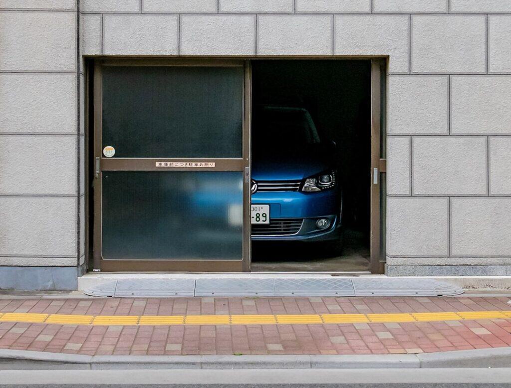 garage, blur glass door, blue car